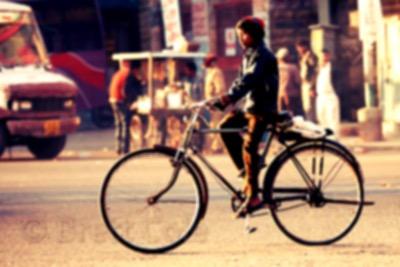 Indian boy Riding a Bike